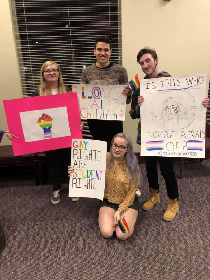 Students display their signs for the February 26th School Board meeting.