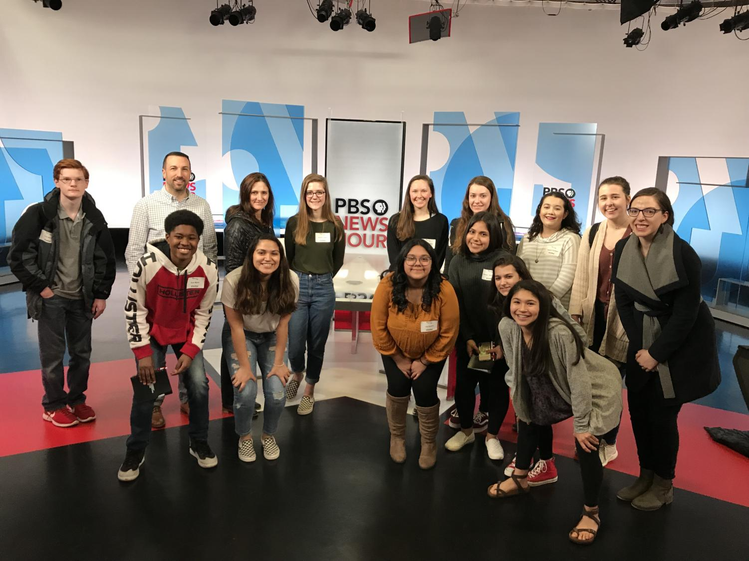 Broadcast and Introduction to Journalism students pose in the NewsHour studio after a tour as part of their day spent at PBS.