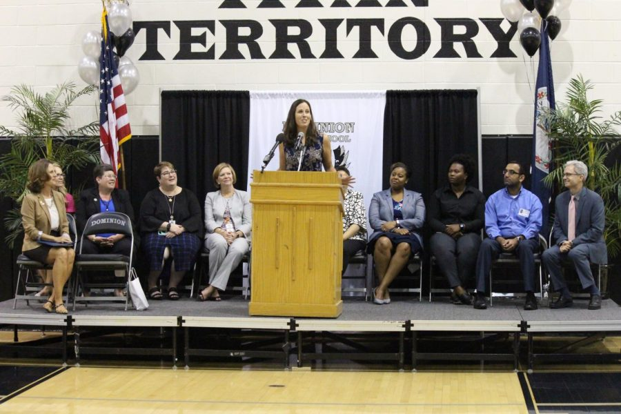 Speaking to the entire student body and special guests, including the Superintendent (far right), Mrs. Rodgers thanked her students for their willingness to explore the world.