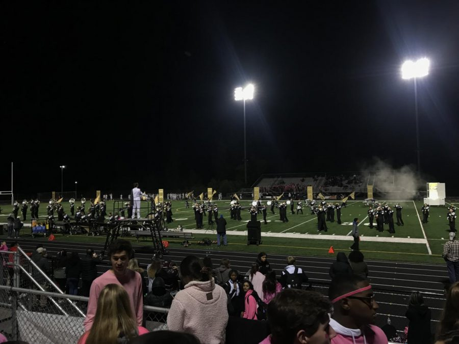 The marching band performing at half time.