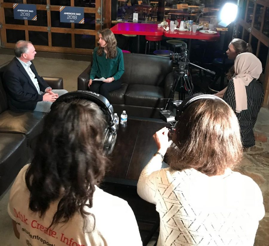 With the support of the SRL producers, Morgan interviews Senator Tim Kaine at a campaign stop at Carpool in Fairfax. Her partners Karen and Alison are behind the cameras.