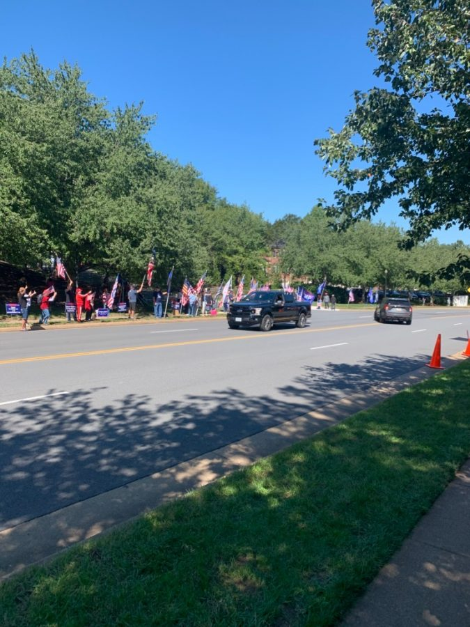 Seen lining the left side of the street are supporters of President Trump. Since the Democratic National Convention, attendance has increased on both sides of the street.