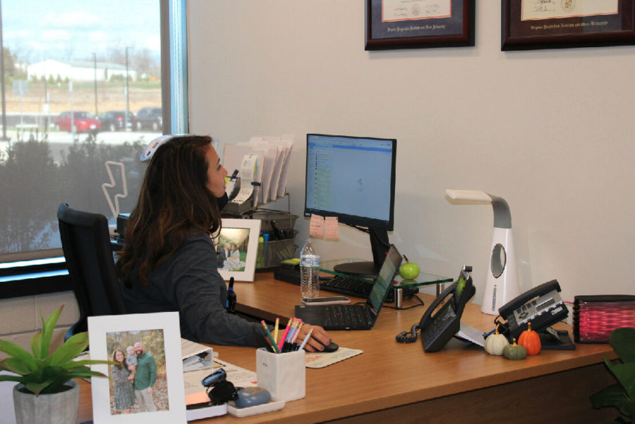 Working in her office at Lightridge, Mrs. Vereb