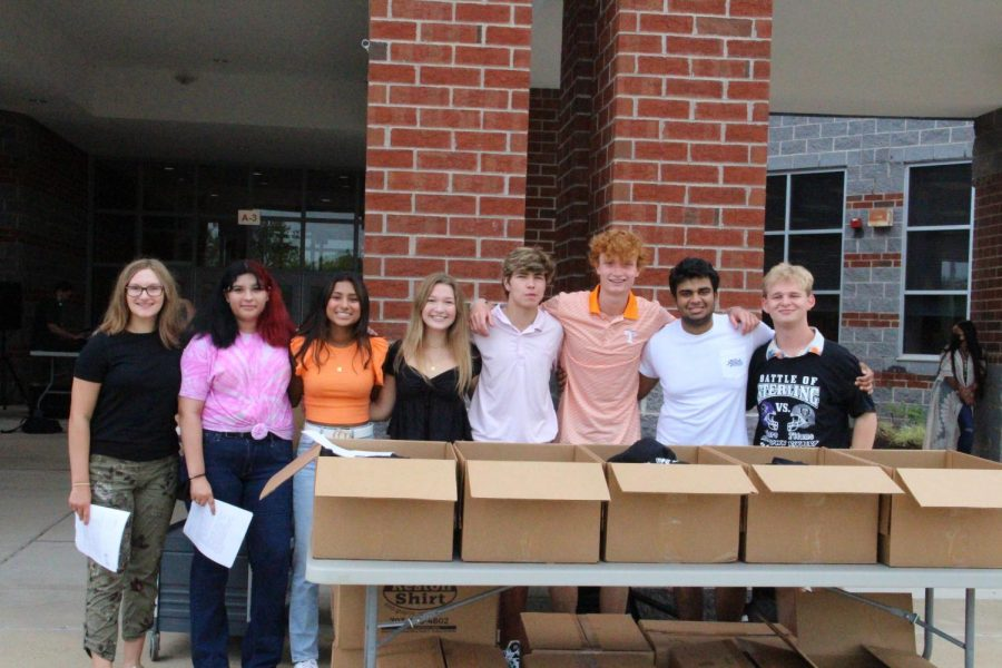 Lined up with boxes of t-shirts for every student, SCA sets the tone for an incredible school year.