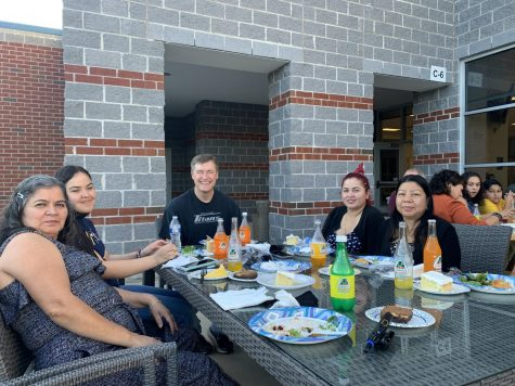 The custodial staff enjoys dinner with Dr. Brewer as staff performed the custodial duties as part of Custodian Appreciation Day.